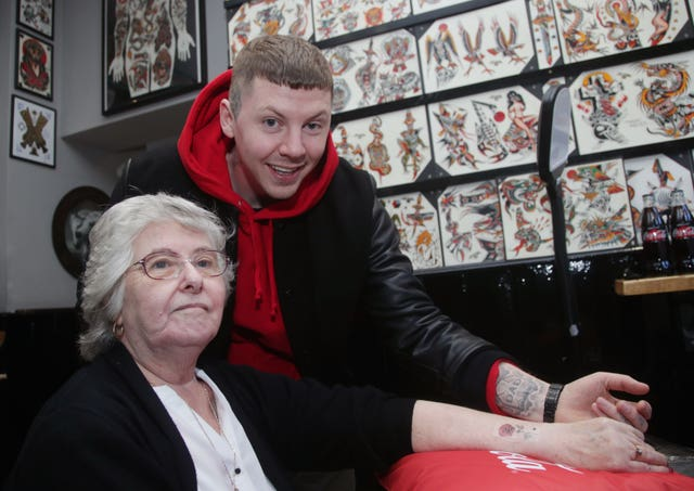 Professor Green and his nan Patricia Robbens, after she had a henna tattoo applied on her arm (Yui Mok/PA)