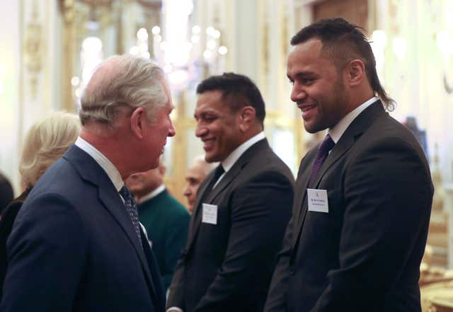 The Prince of Wales meets rugby players Mako and Billy Vunipola (Jonathan Brady/PA)