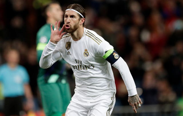 Real Madrid skipper Sergio Ramos celebrates after scoring from the penalty spot