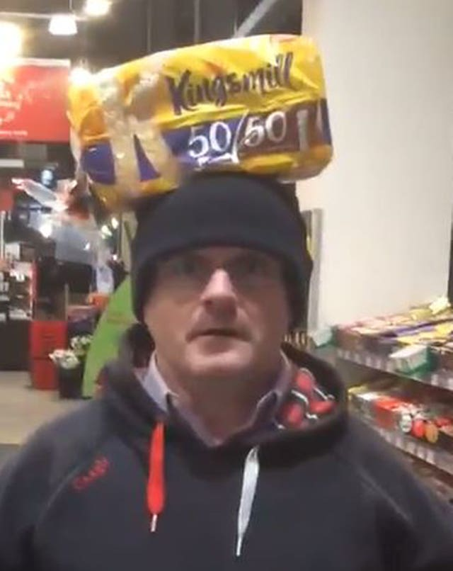 Barry McElduff with a Kingsmill-branded loaf on his head (Barry McElduff/Twitter/PA)
