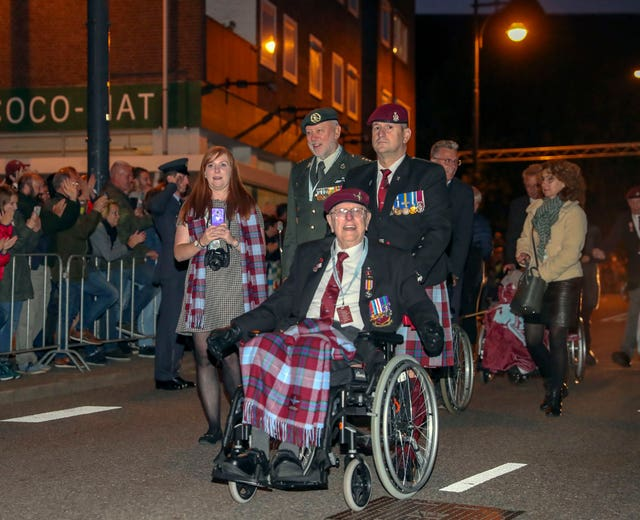 Former paratrooper Sandy Cortmann, front, from Aberdeen, joins the march to The Bridge to Liberation Experience held on the John Frost Bridge in Arnhem, the Netherlands