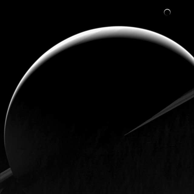 Saturn and one if its moons, Titan, seen from the Cassini spacecraft