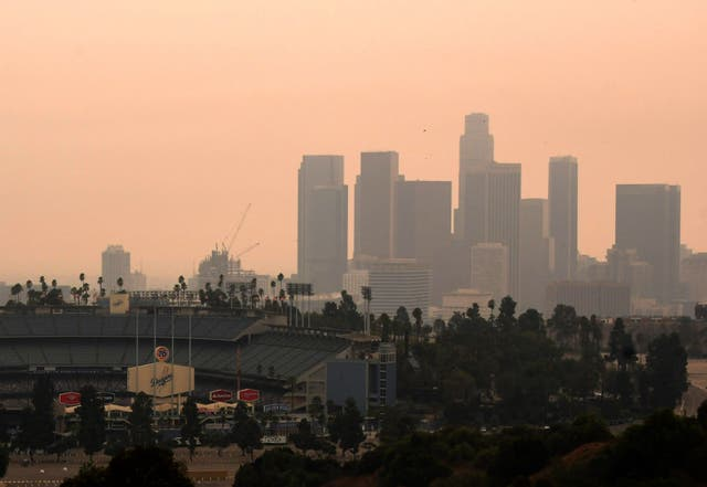 Downtown Los Angeles and Dodger Stadium are shrouded in smoke from the Bobcat and the El Dorado fires
