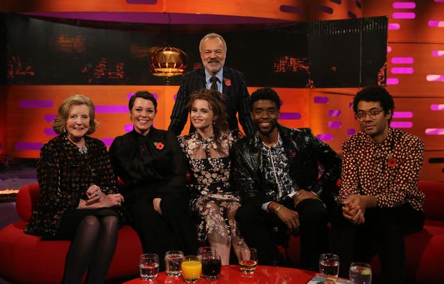 Host Graham Norton with (seated left to right) Lady Anne Glenconner, Olivia Colman, Helena Bonham Carter, Chadwick Boseman and Richard Ayoade