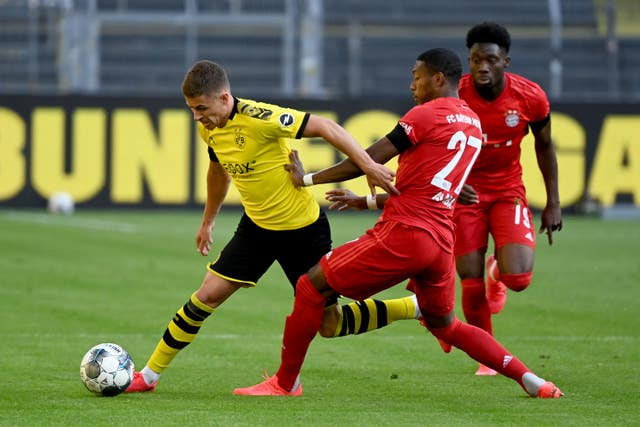 Joshua Kimmich's stunning chip sinks Dortmund as Bayern move seven points clear