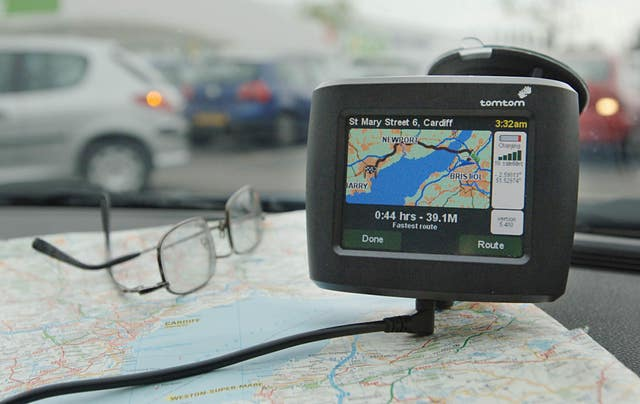 A tomtom satellite navigation on the dashboard of a car (Barry Batchelor/PA)