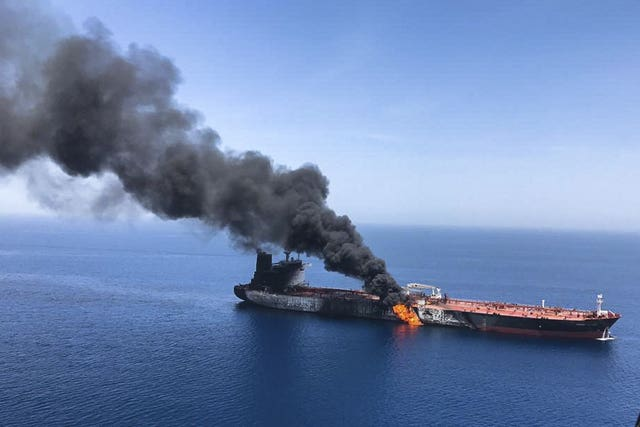 An oil tanker on fire in the sea of Oman