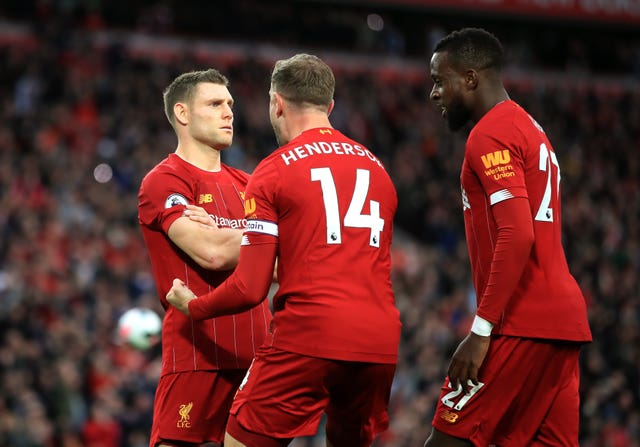 James Milner (left) kept his cool to score a stoppage-time penalty as Premier League leaders Liverpool maintained their perfect start at Anfield.
