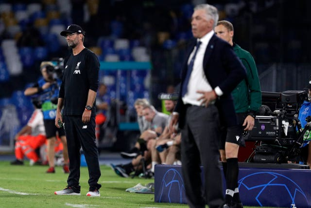 Liverpool manager Jurgen Klopp, left, watches on as his side lost in Italy