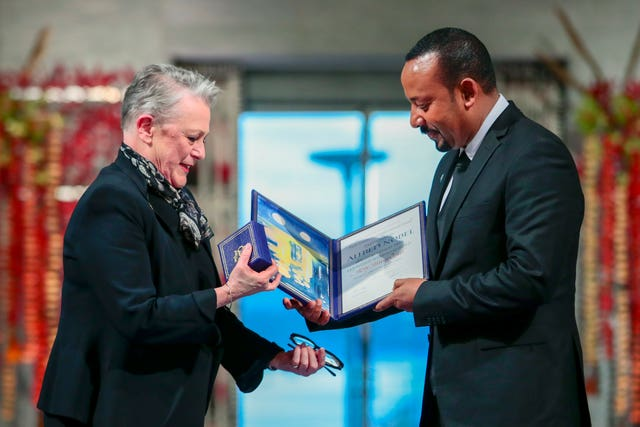 Chairman of the Nobel Committee Berit Reiss-Andersen presents the award to Abiy Ahmed