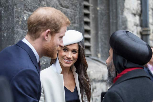 Prince Harry and Meghan Markle talk to Archbishop Angeaelos, Coptic Orthodox Archbishop of London in Dean's Yard (Jack Hill/The Times/PA)