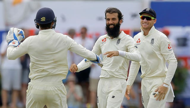 Moeen Ali, centre, celebrates the wicket of Sri Lanka's Dimuth Karunaratne (Eranga Jayawardena/AP).
