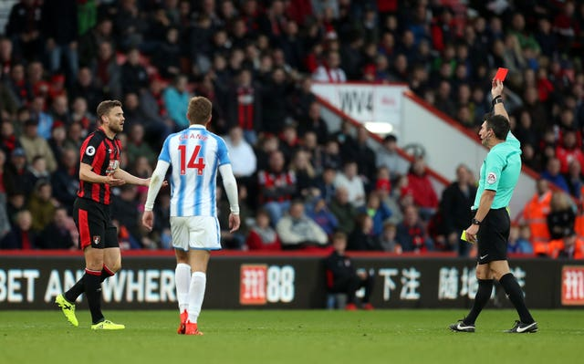 Bournemouth's Simon Francis is shown the red card