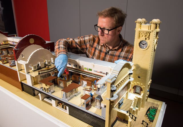 Technician Alistair MacKillop with a Lego model of the Horniman Museum