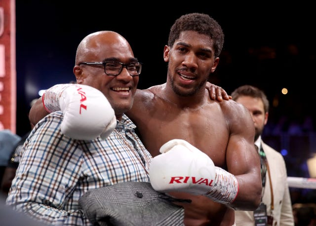 Joshua with his father Robert after reclaiming the IBF, WBA, WBO and IBO heavyweight titles
