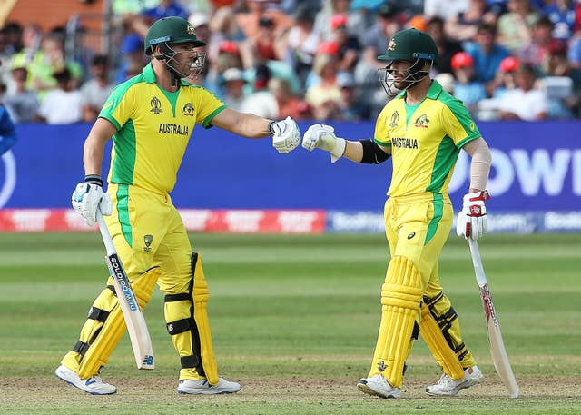 Warner (right) and Finch walk to the crease