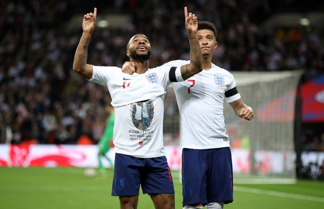 Sterling shows his t-shirt tribute following his side's third goal of the game (Nick Potts/PA)