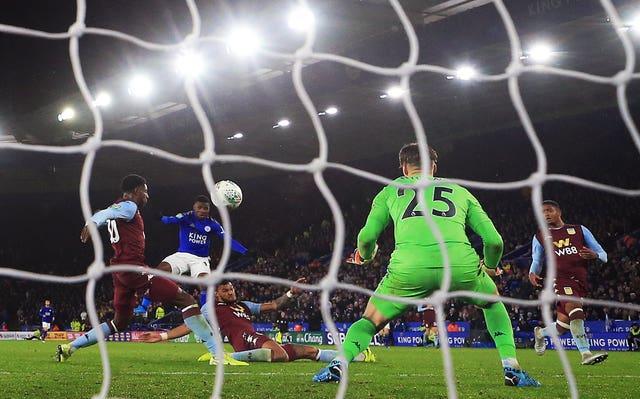 Kelechi Iheanacho, centre, scores for Leicester against Aston Villa
