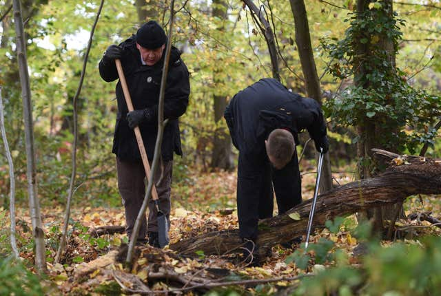 Police officers search an area of Coombe Country Park in Coventry after receiving new witness information relating to the disappearance of Nicola Payne (Joe Giddens/PA)