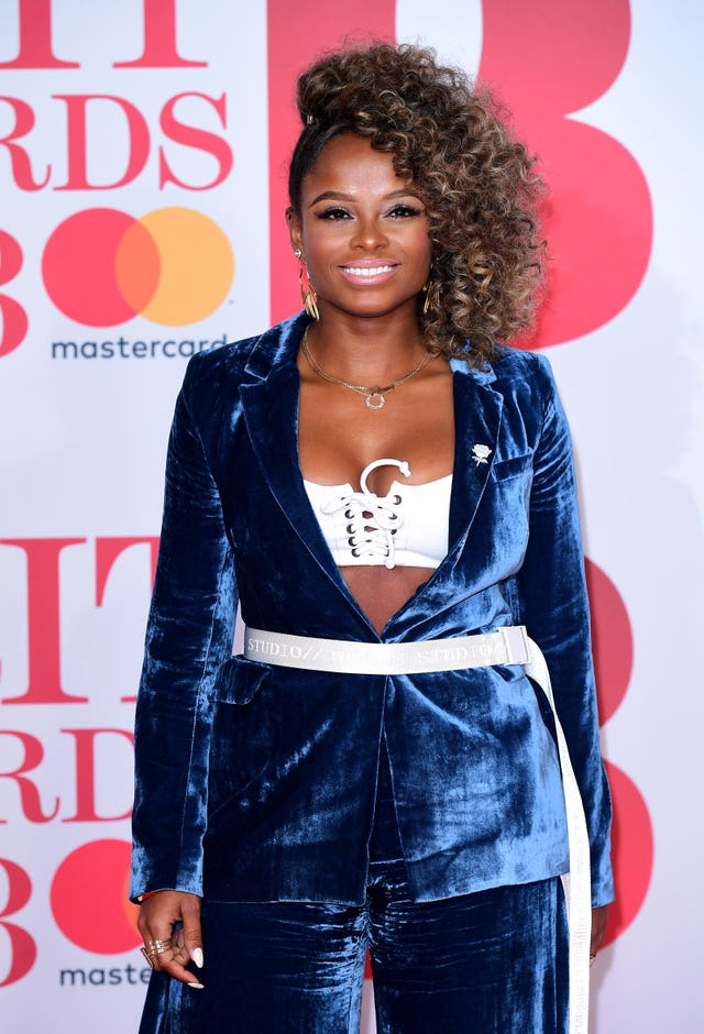 Fleur East arrives for the Brit Awards (Ian West/PA)
