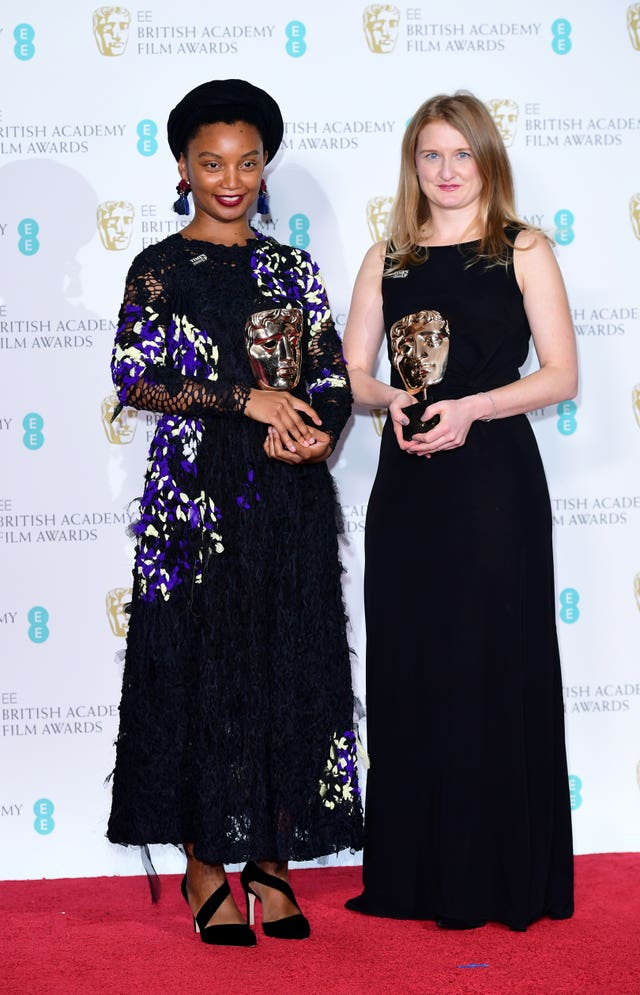 Rungano Nyoni and Emily Morgan with the Bafta for outstanding debut for I Am Not A Witch (Ian West/PA)
