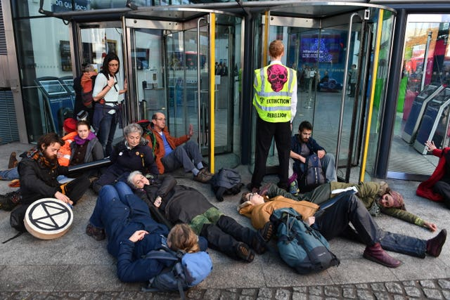 Fracking protesters glue themselves to Government building ...