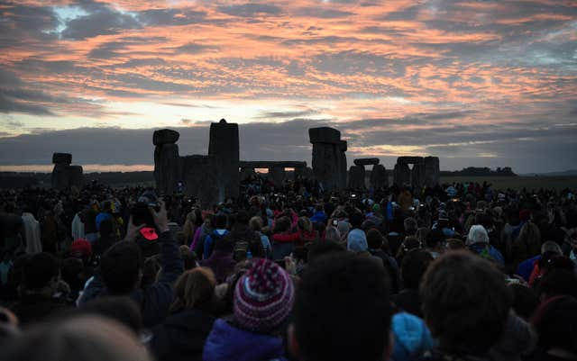 Summer solstice at Stonehenge is still a cause for celebration, but experts now believe building the monument was also important to ancient people (Andrew Matthews/PA)