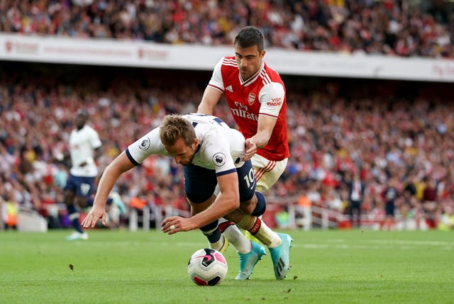 Sokratis Papastathopoulos, right, challenges Harry Kane in the penalty area