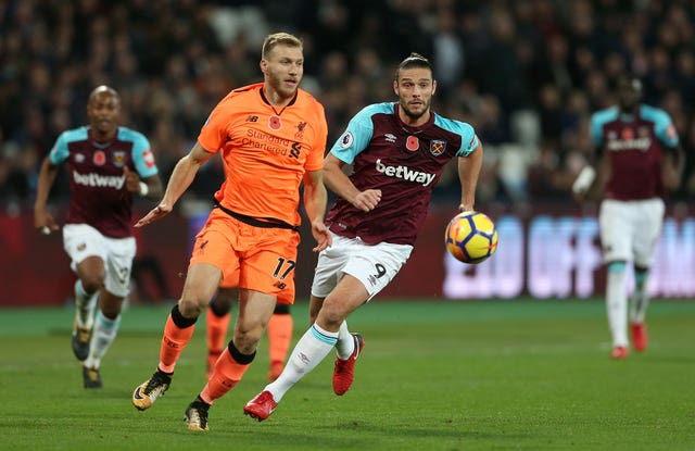 Liverpool and West Ham players battle for the ball Premier League – London Stadium