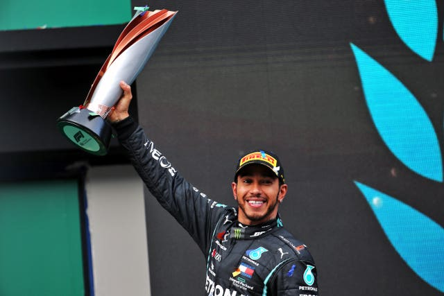 Lewis Hamilton celebrates winning the world title for a seventh time