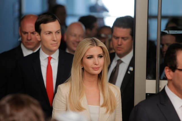 Mr Trump's daughter Ivanka and senior White House adviser Jared Kushner arrive for the opening ceremony (AP)