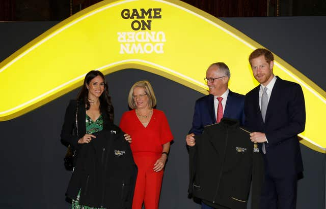 Prince Harry and Meghan Markle receive Invictus Games jackets from Australian PM Malcolm Turnbull (Alastair Grant/PA)