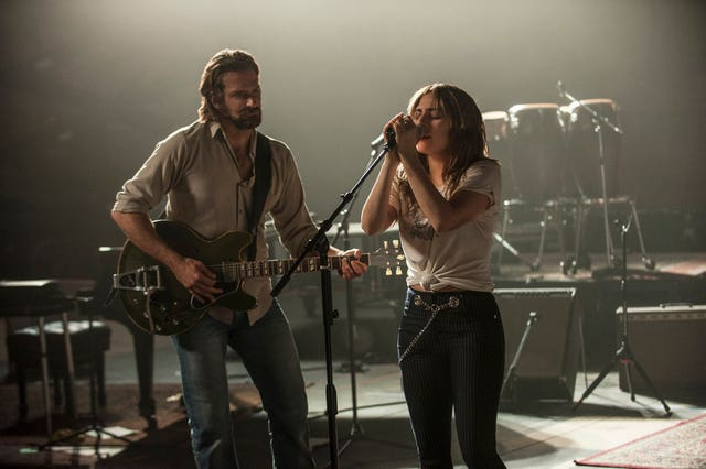 Lady Gaga appearing alongside Bradley Cooper in A Star Is Born