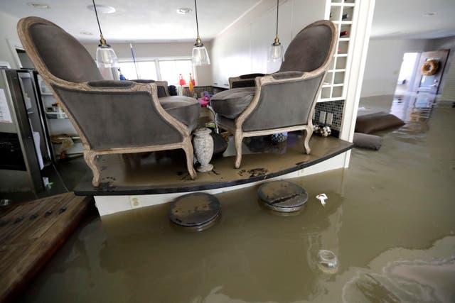 Chairs sit atop a counter inside the flooded home of Gaston Kirby