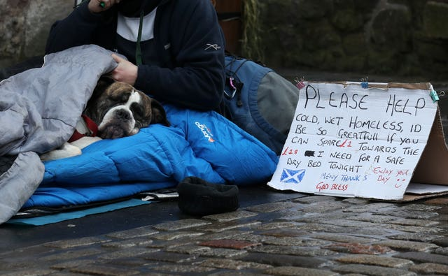 A homeless person and their dog in Edinburgh