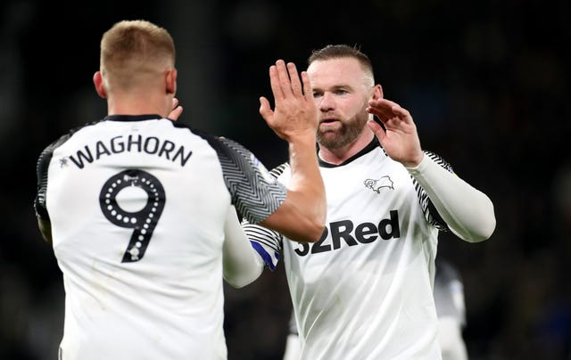 Martyn Waghorn (left) celebrates his goal with Wayne Rooney
