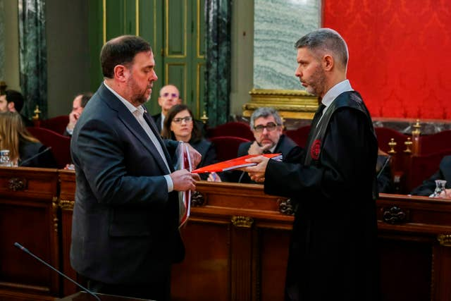 Oriol Junqueras, left, speaks with his lawyer