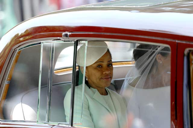Meghan rides in a car accompanied by her mother, Doria Ragland (Aaron Chown/PA)