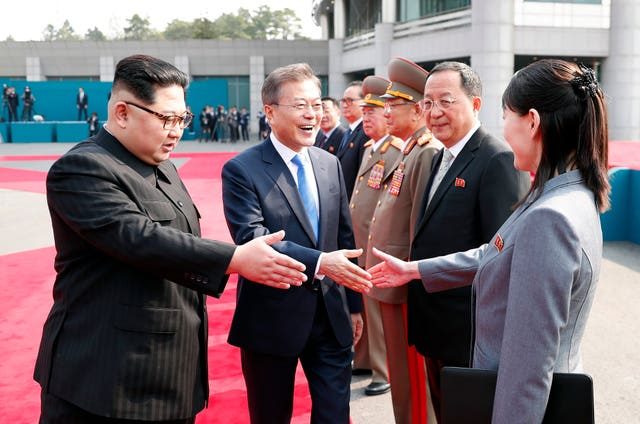 Mr Moon also shook hands with Mr Kim's sister Kim Yo Jong, who was part of the delegation from the north (Korea Summit Press Pool via AP)