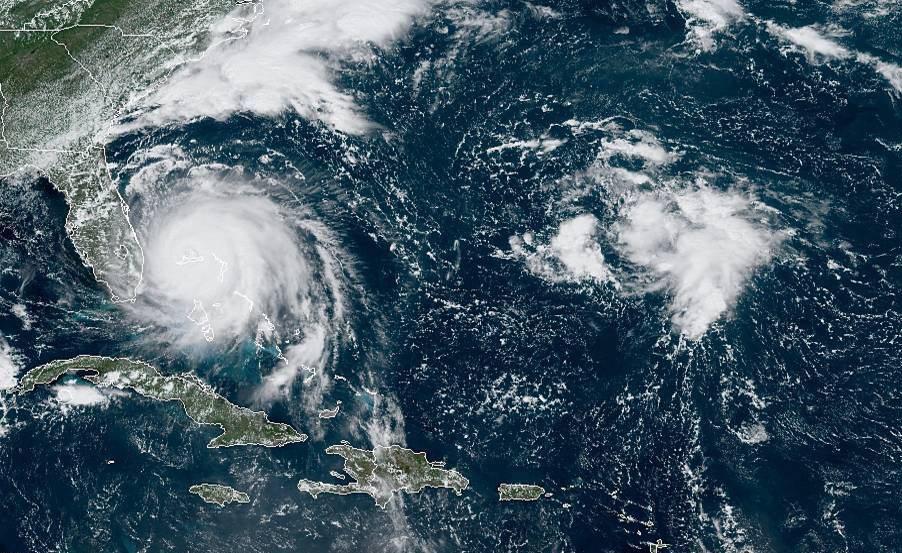 Hurricane Dorian hovered over the Bahamas on Monday pummelling the islands