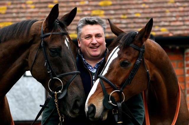 Paul Nicholls with Denman (left) and Kauto Star