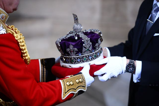 The Imperial State Crown is carried through the Sovereign's Entrance ahead of the State Opening