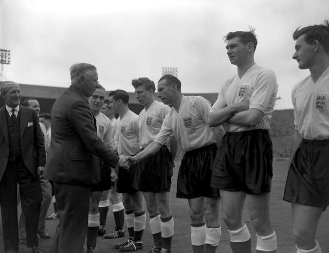 The Duke of Norfolk shakes hands with Stanley Matthews