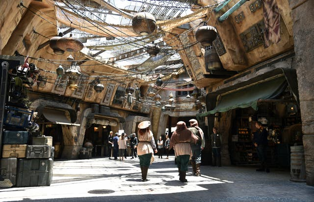Characters stroll through the marketplace at the Black Spire Outpost at Star Wars: Galaxy's Edge at Disneyland