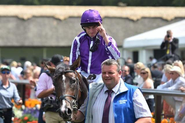 Ryan Moore celebrates a first July Cup victory with US Navy Flag