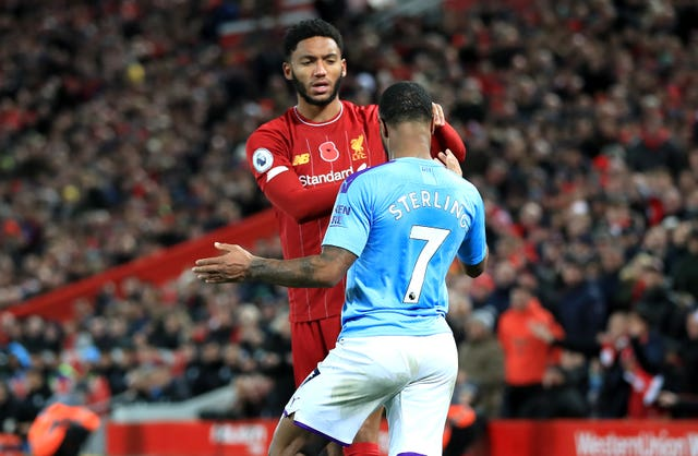 Raheem Sterling clashes with Joe Gomez, left, in Manchester City's defeat to Liverpool