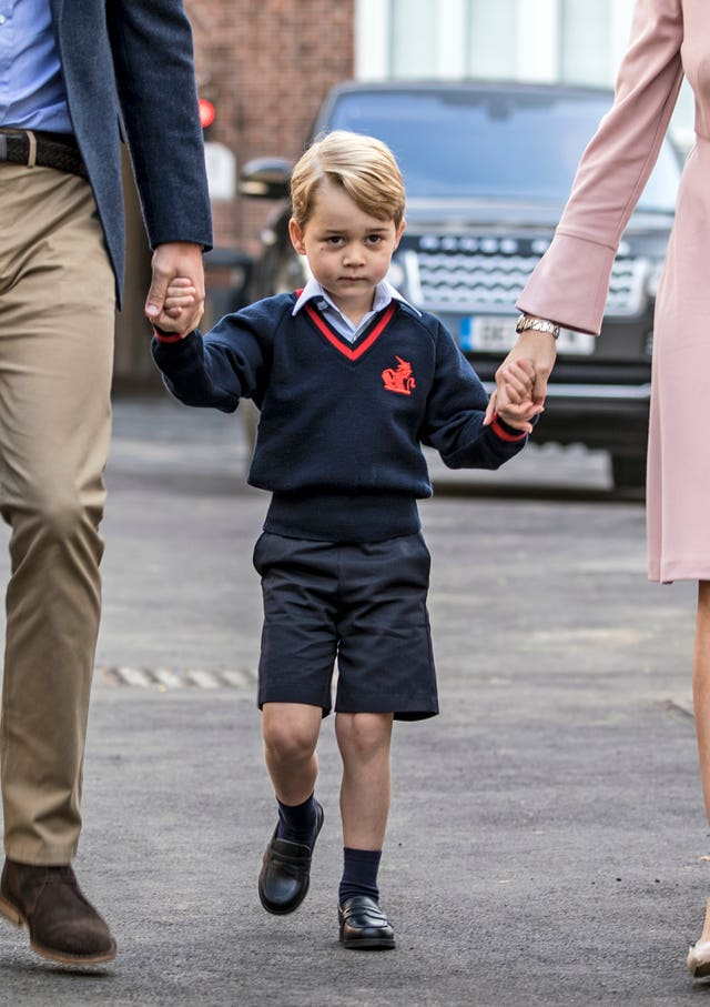 Prince George meets teacher Helen Haslem alongside his father the Duke of Cambridge on his first day at school at Thomas's Battersea (Richard Pohle/The Times/PA)