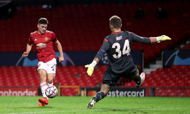 Daniel James, left, scores United's fourth goal