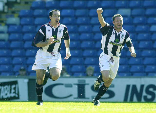 Derek McInnes, right, celebrates during a West Brom game