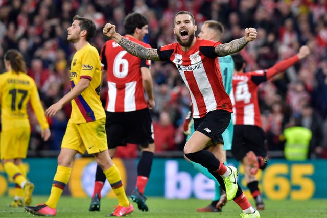 Inigo Martinez celebrates at full-time